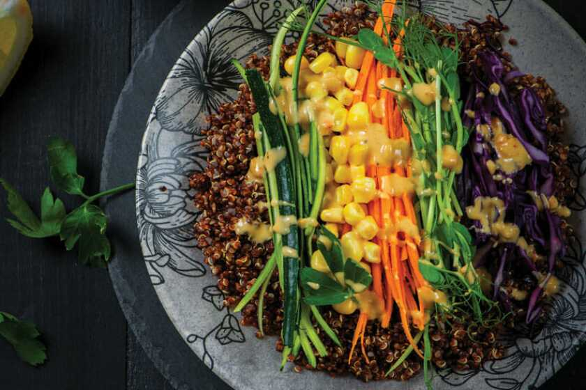 A bowl of quinoa and variety of vegetables
