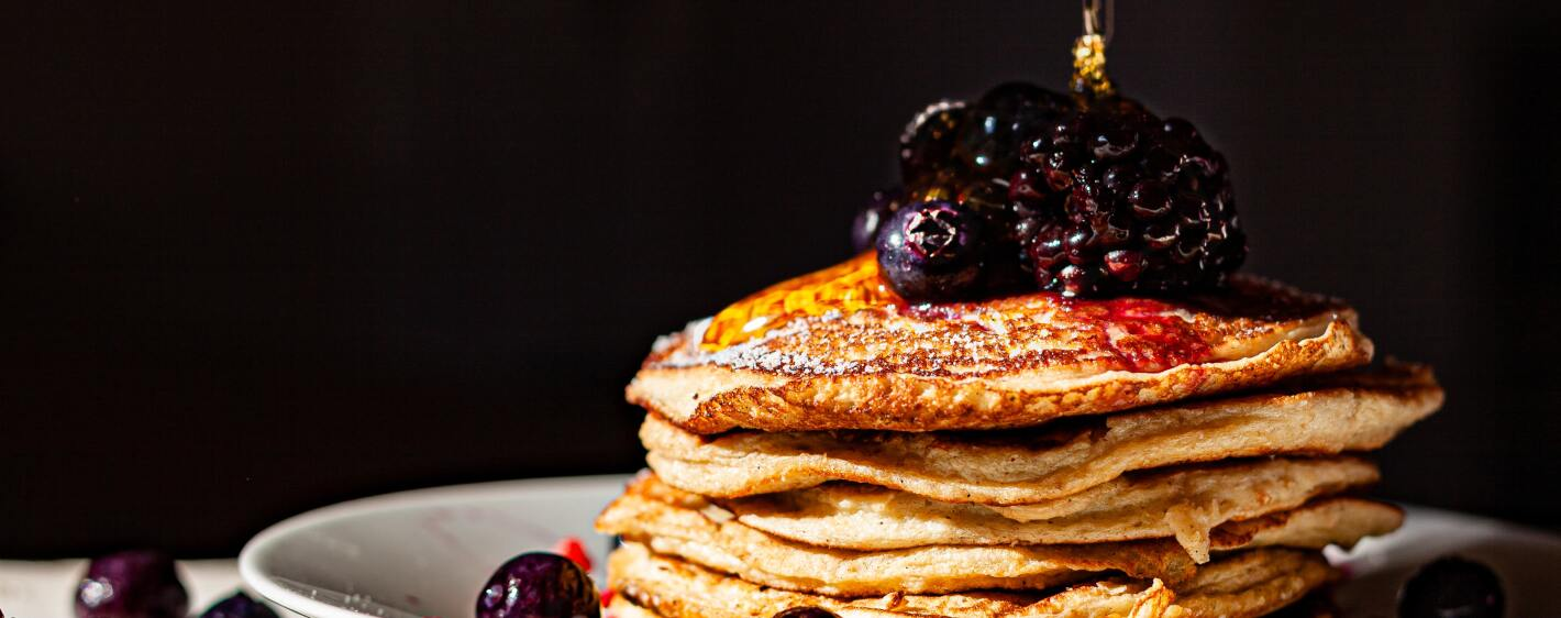 Sweet Potato Pancakes with berries and honey