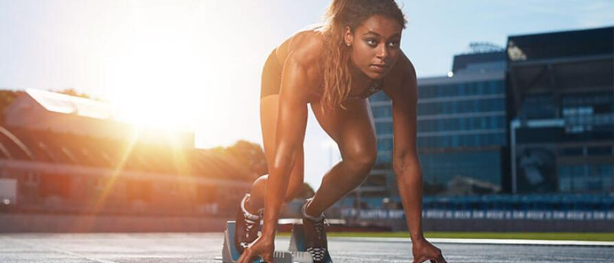 female athlete preparing for track race