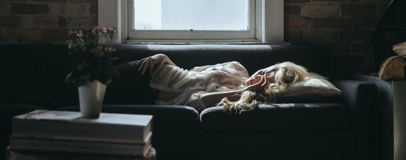 Girl asleep in a loft with flowers