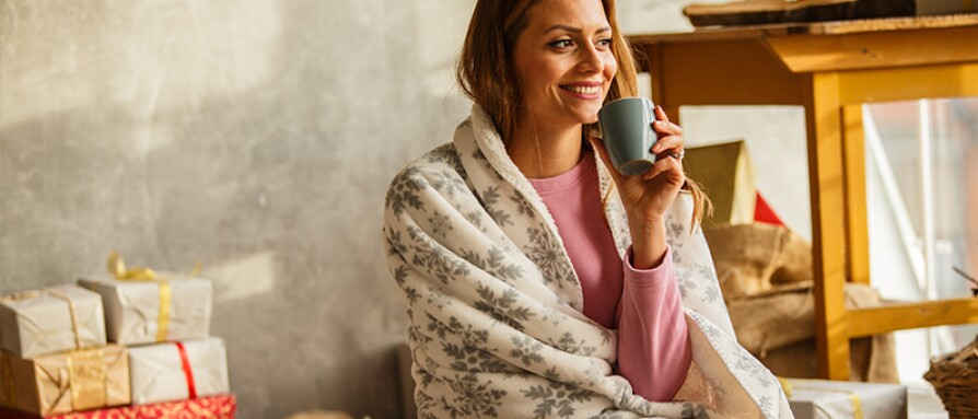 woman smiling chirstmas morning
