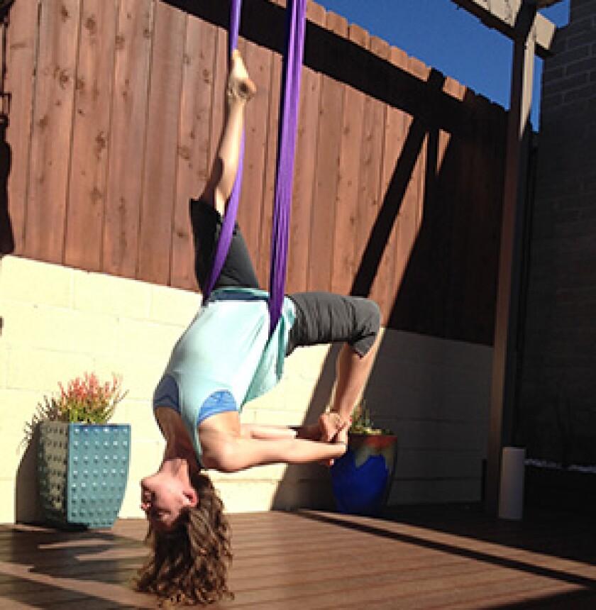 woman doing aerial yoga