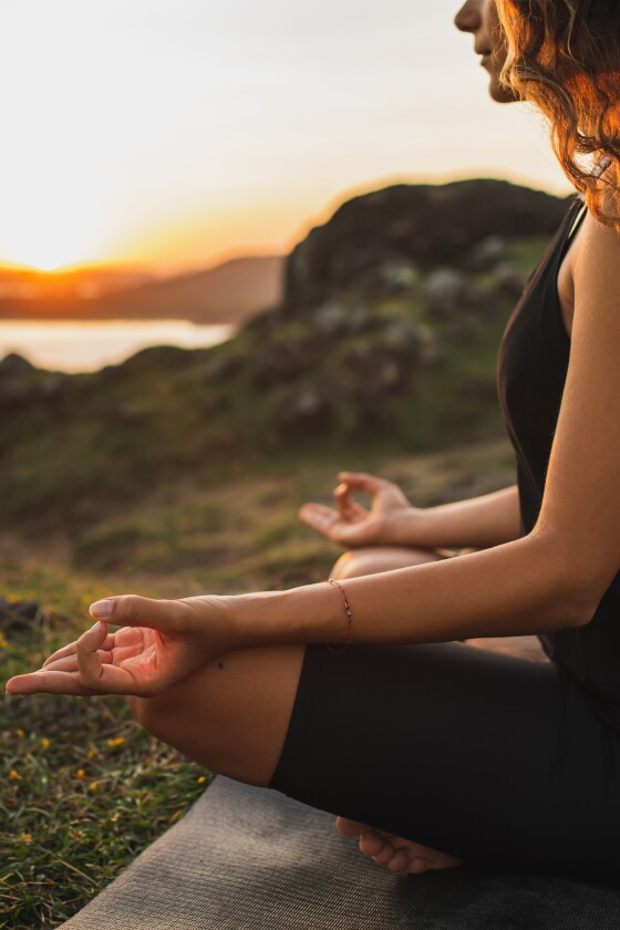 woman meditating outdoor sunrise