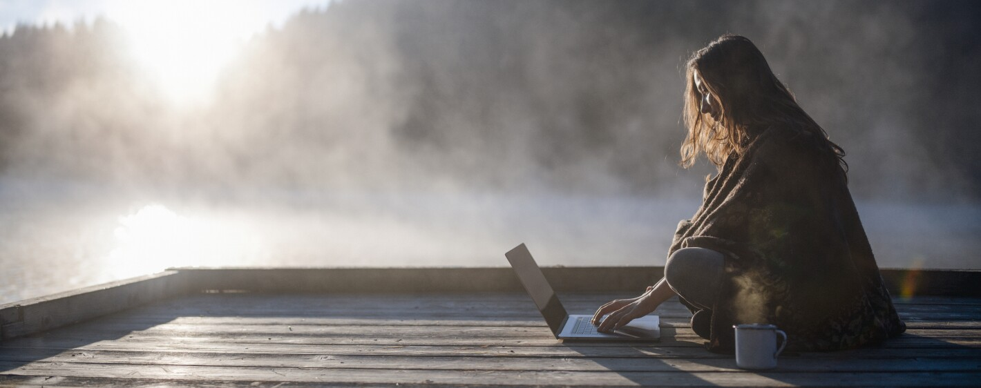 Woman Relaxing In Nature And Using Technology.