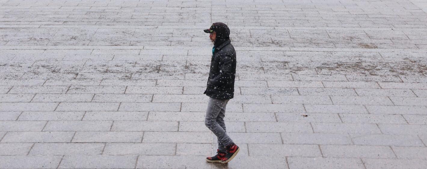 Guy walking in winter snow