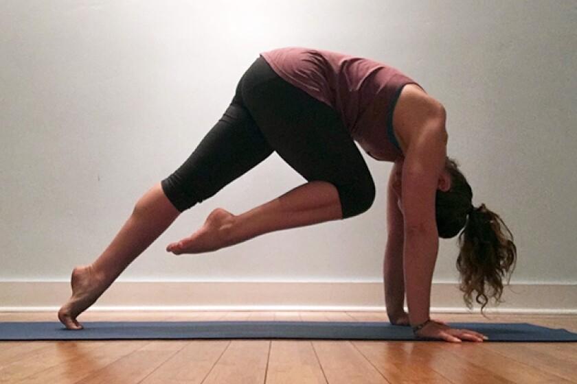 Yoga teacher in tiger pose