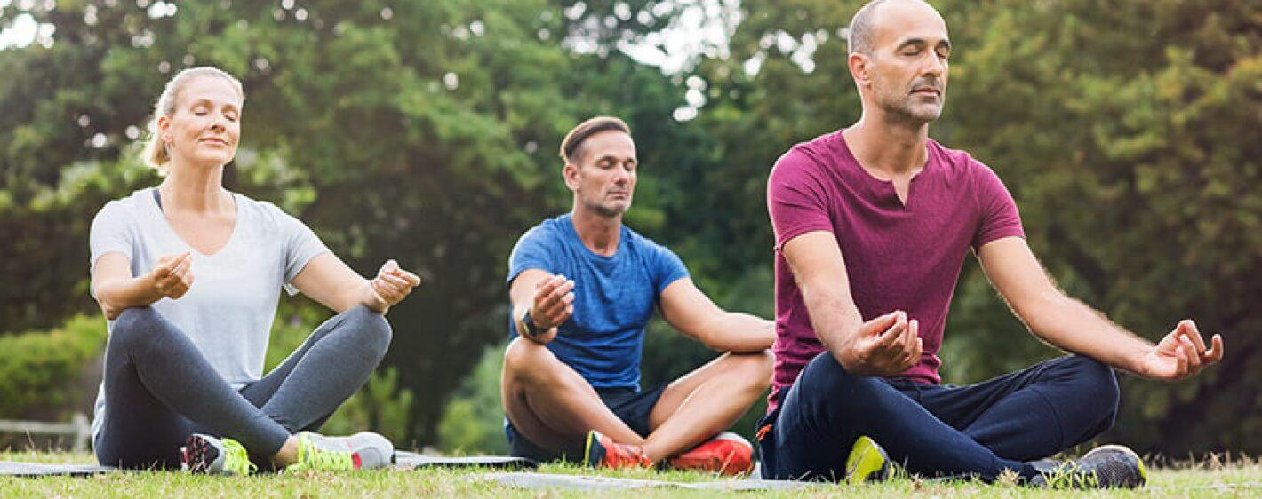 group meditating outdoors