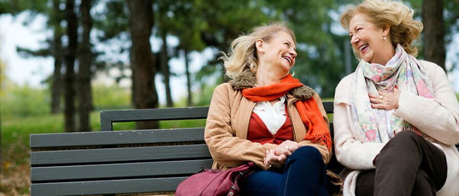 Friends laughing mature woman