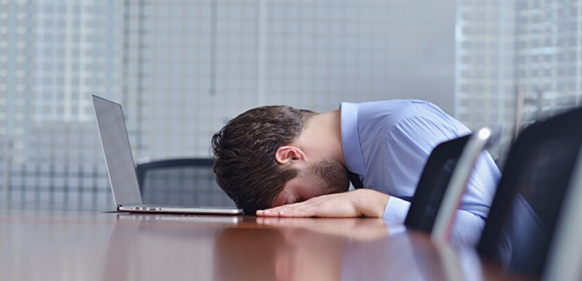 man head on desk