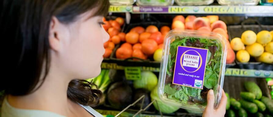 woman shopping for organic greens