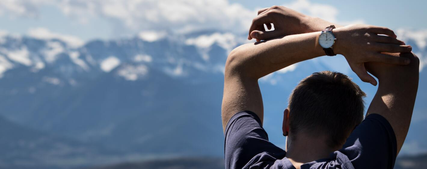 Guy in mountains wearing a watch