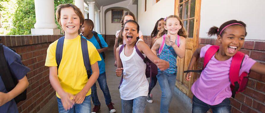 school children running down hallway