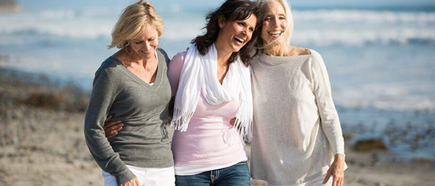 women walking on the beach with friends
