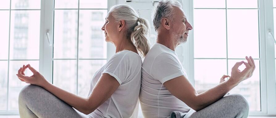 mature couple meditating