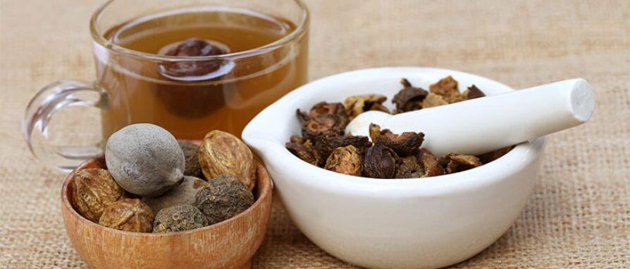 Triphala herbal formula in a bowl