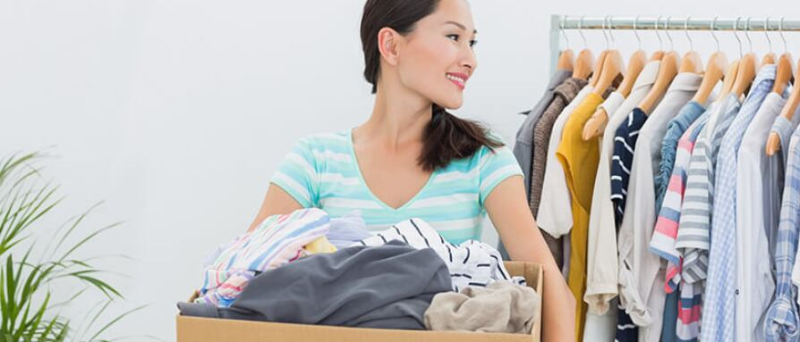 A young woman organizing and decluttering her home