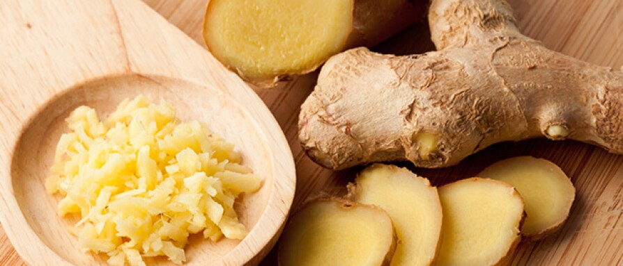 Fresh and grated ginger on a wooden board