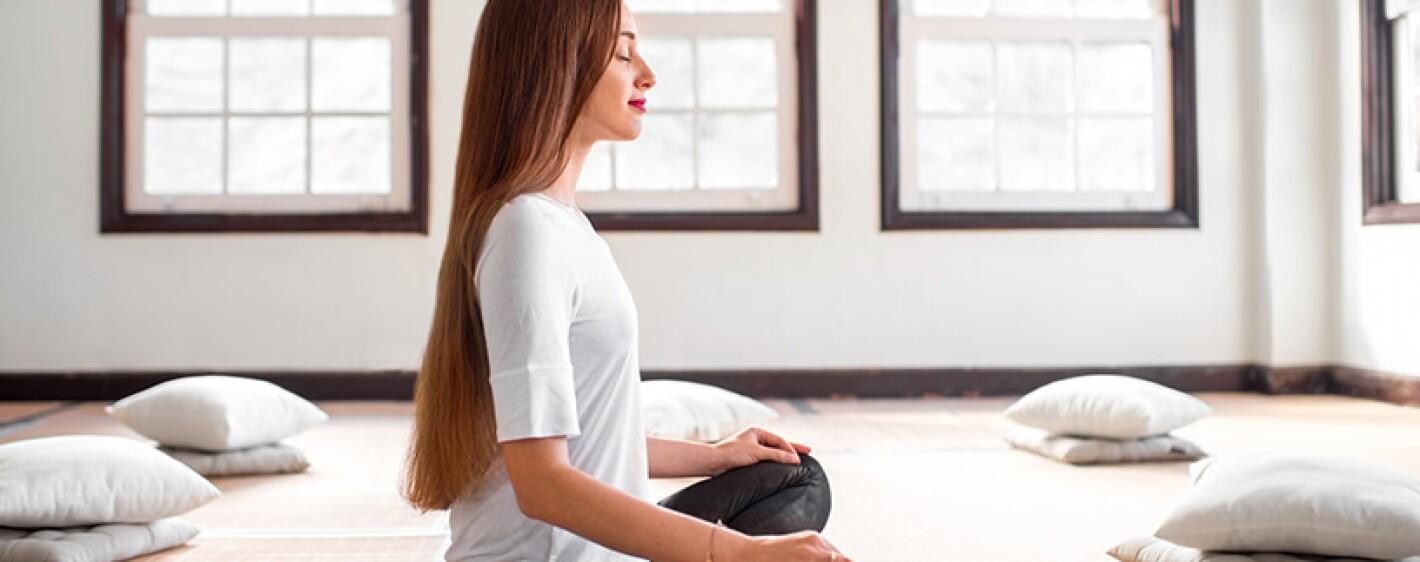woman with long hair meditating