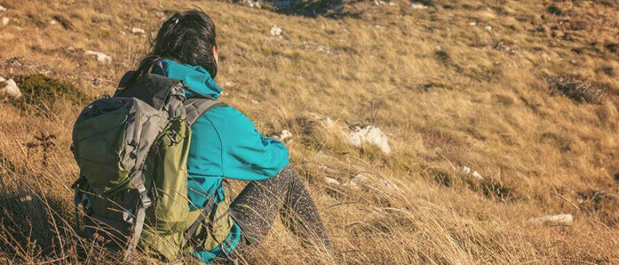 woman traveler sitting down