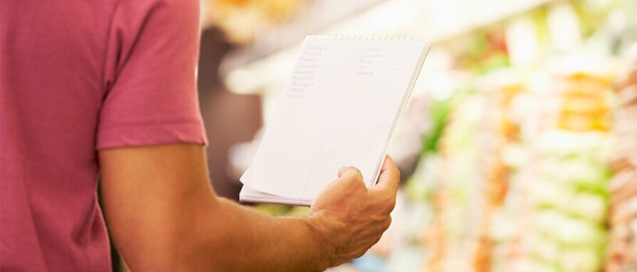 Close Up Of Man Reading Shopping List