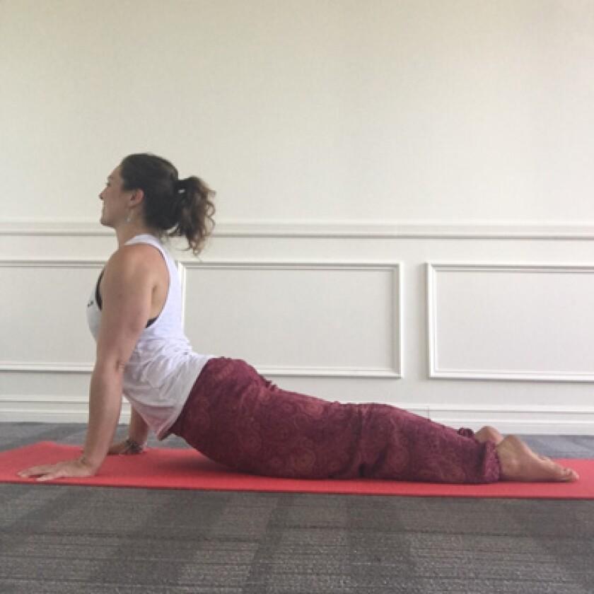 Woman in upward facing dog yoga pose