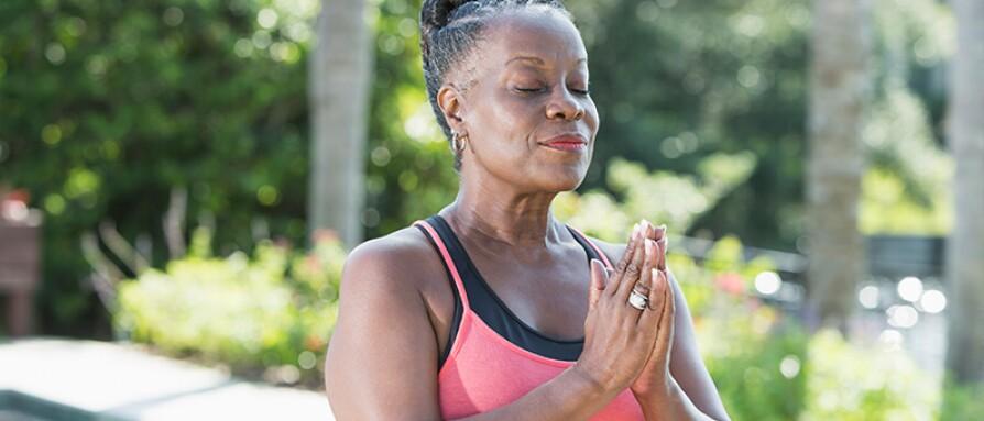 woman hands heart center prayer meditation