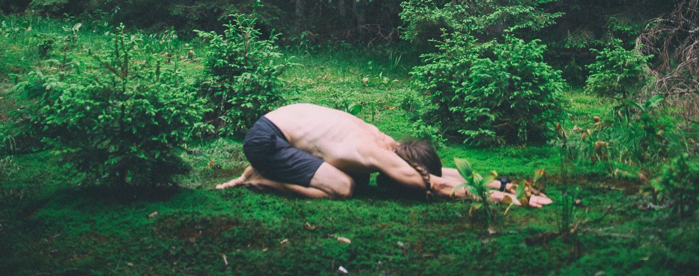 Guy doing yoga outside