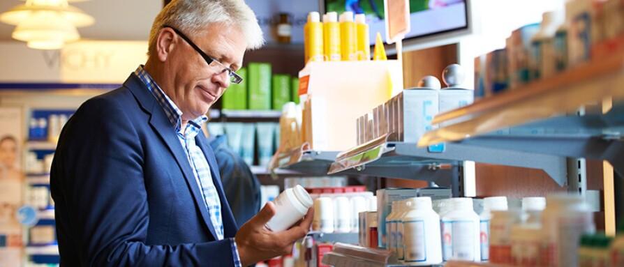 man reading bottle