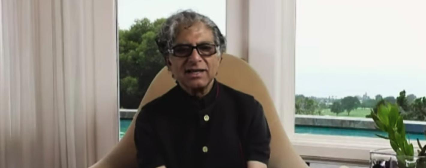 Deepak Chopra sitting at home