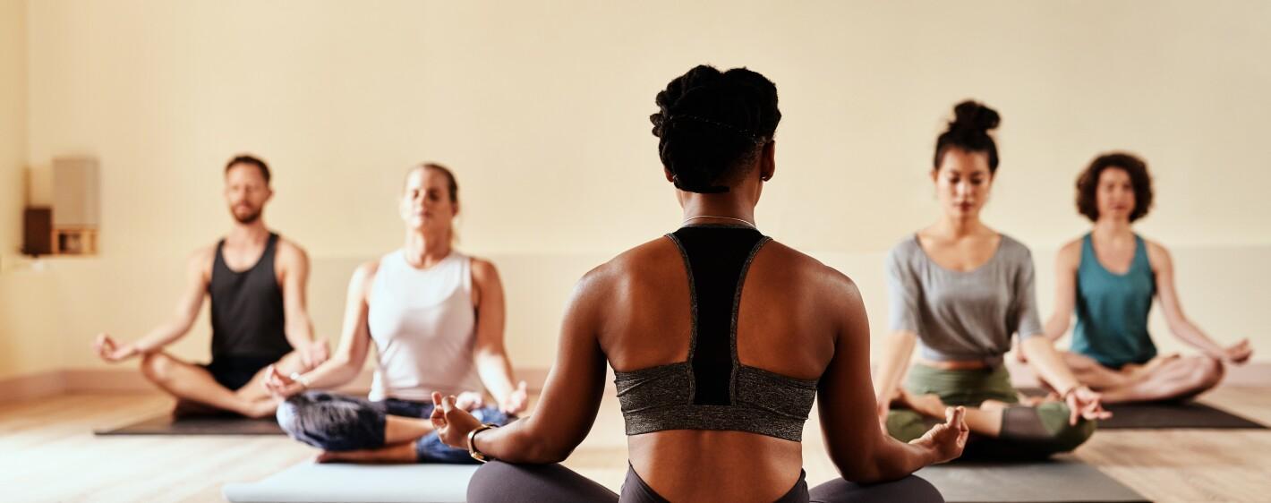 man in yoga meditation class