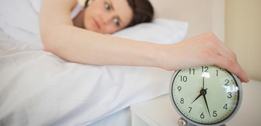 woman hitting snooze