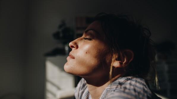 woman eyes closed sunlight