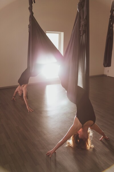 Young women practicing aerial yoga