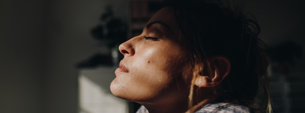 woman eyes closed sunlight