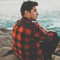 Guy in a red and black checkered flannel at the beach