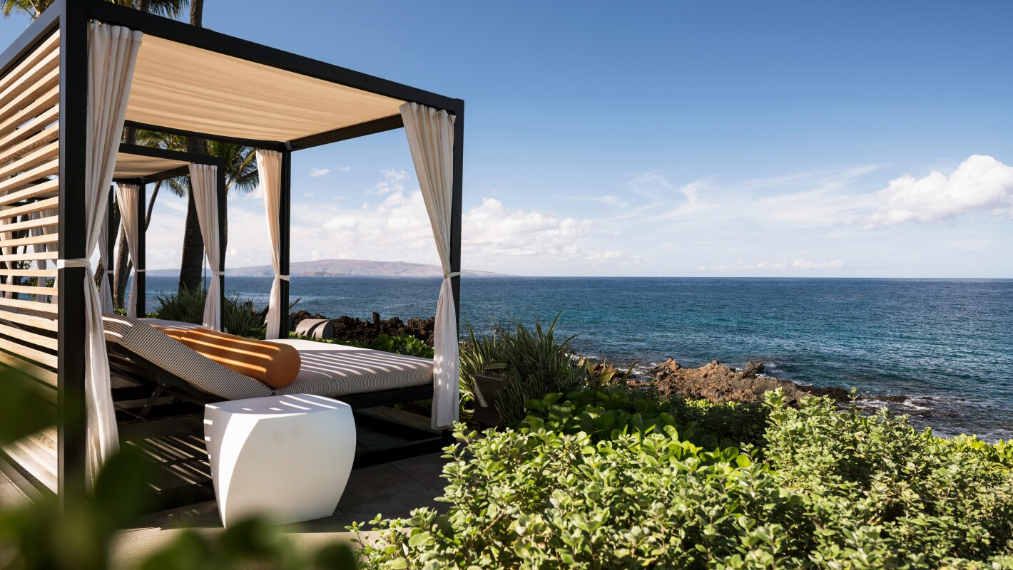 An image of cabana bed looking at the ocean