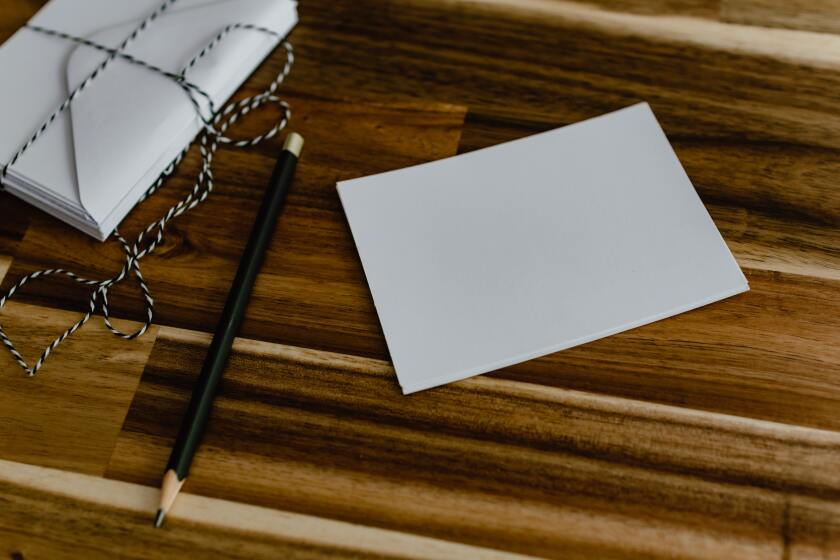 A close up of a note card and pencil
