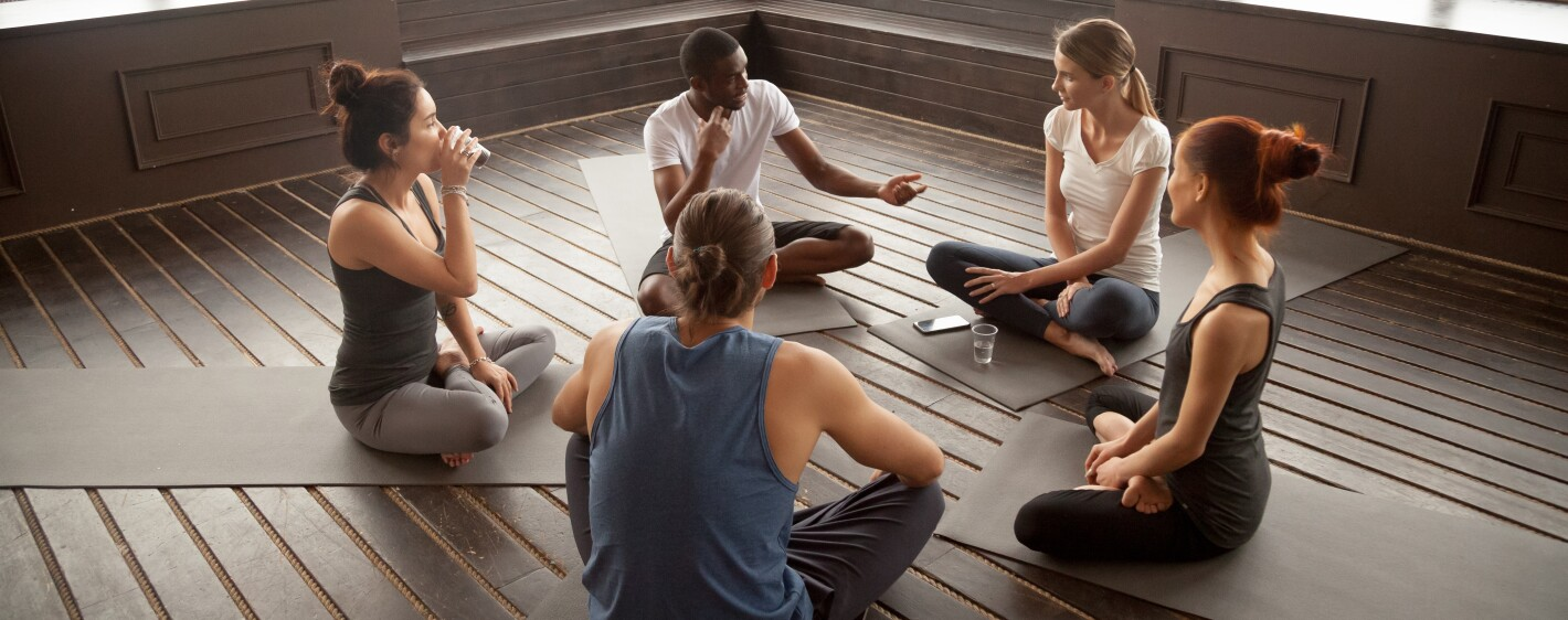 Group seated and talking together in circle