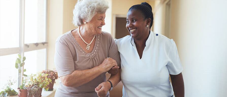 caregiver and woman smiling