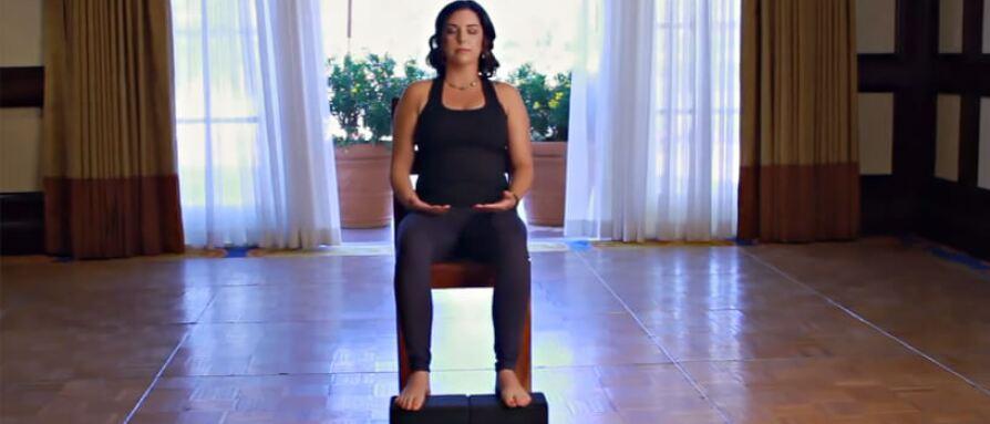 Woman doing chair yoga