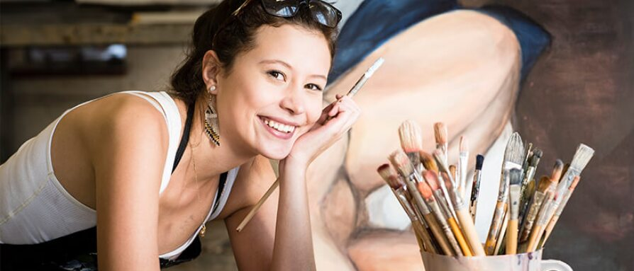 smiling young woman painting