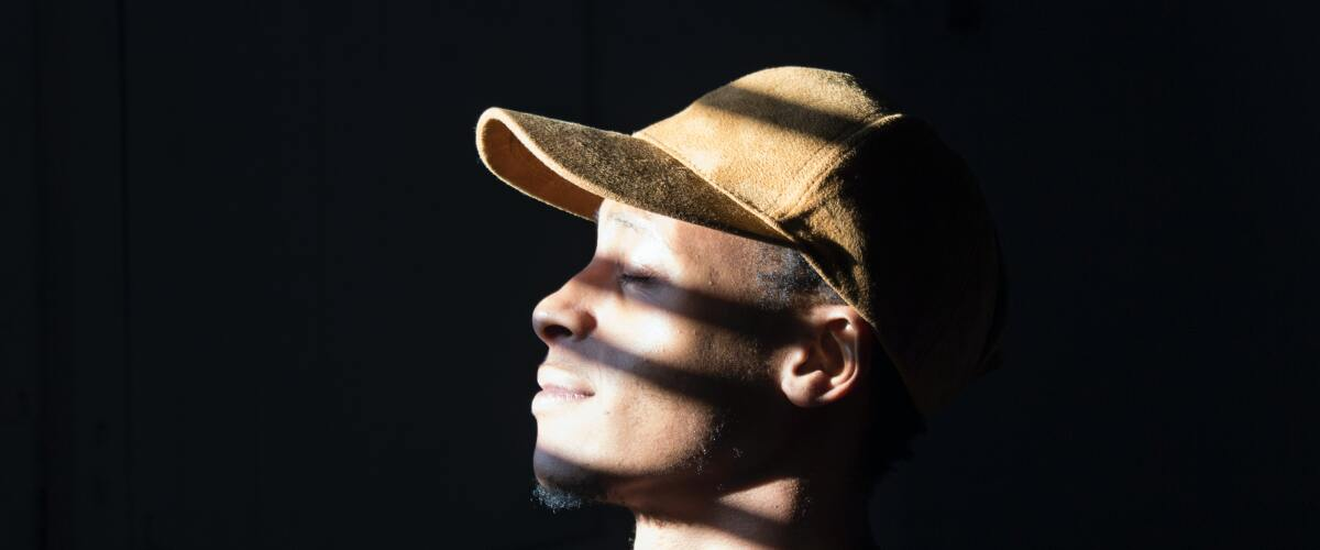 A young Afro-American man looking out