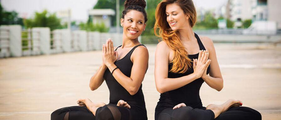 woman doing yoga together