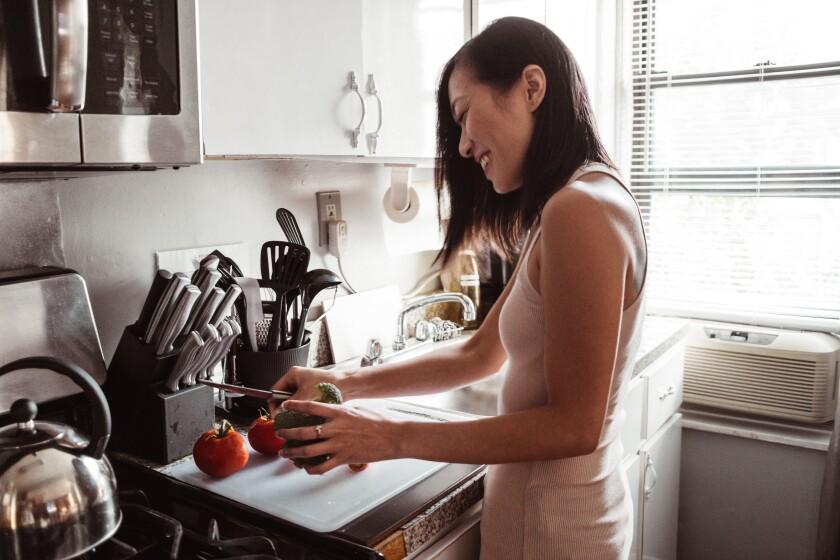 chinese woman preparing food at home