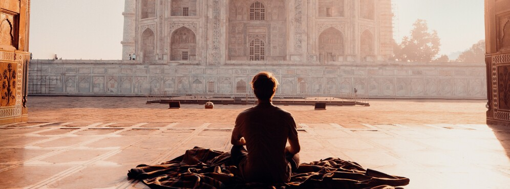 person-sitting-in-front-of-the-taj-mahal-2387871.jpg