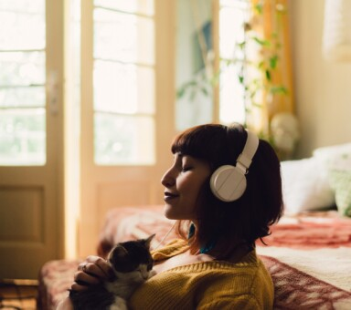 woman listening white headphones