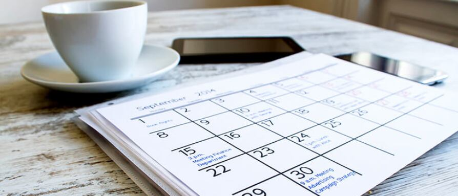 calendar and coffee on table