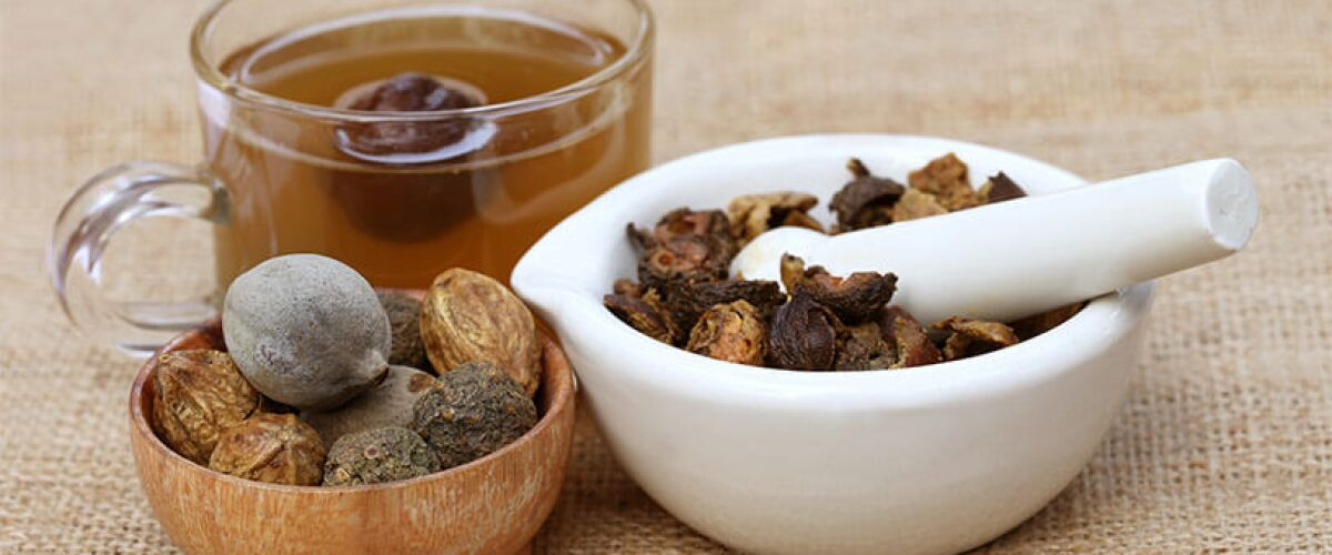 Triphala herbal formula in a bowl