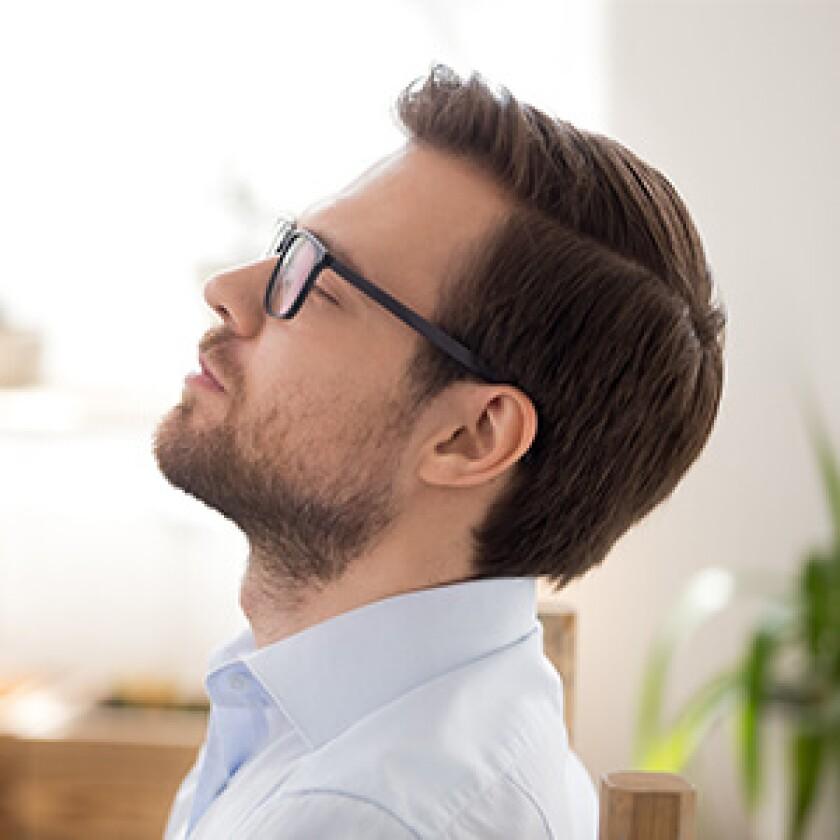 man taking a deep breath