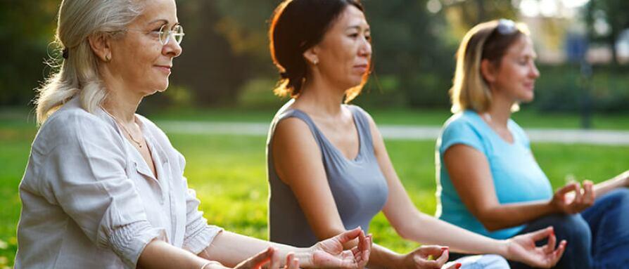 three women meditating